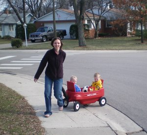 Michelle pulling kids in wagon